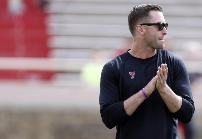 Texas Tech coach Kliff Kingsbury stands during a spring NCAA college football game Saturday, April 12, 2014, in Lubbock, Texas. (AP Photo/The Avalanche-Journal, Tori Eichberger)